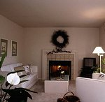 click to view this living room in a before and after view of the starry ceiling mural